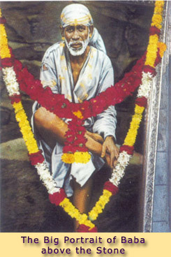 THE BIG PORTRAIT OF BABA ABOVE THE STONE