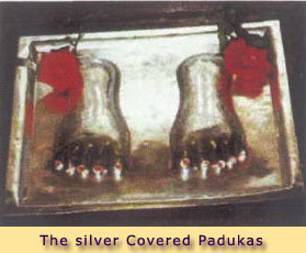 THE SILVER COVERED PADUKAS IN FRONT OF BABA'S PORTRAIT